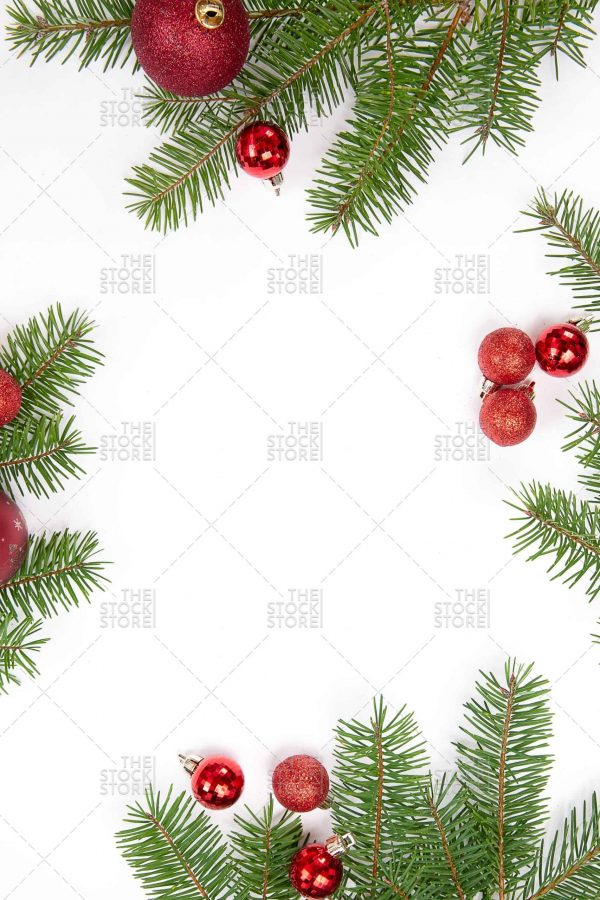 PIne with red ornaments styled stock photo