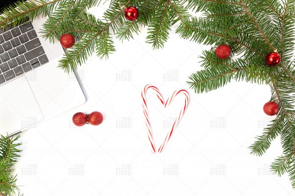 Photo of laptop with branches and candy cane
