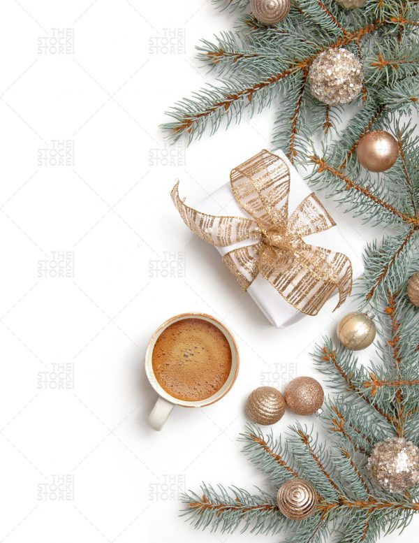 Photo of evergreen branches and a wrapped gift