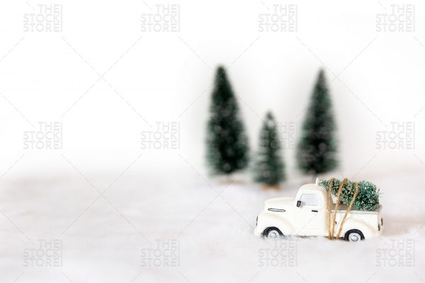 White toy truck with christmas tree