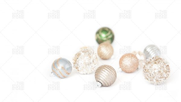Photo of white and gold christmas ornaments